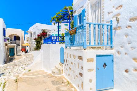 Beautiful Greek houses on street of Naoussa village, Paros island, Cyclades, Greece Stock Photo