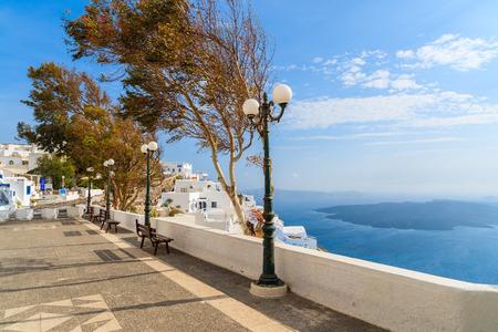 Coastal promenade with view of caldera in Firostefani village on Santorini island, Greece