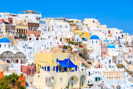 View of famous Oia village with colourful houses, Santorini island, Greece