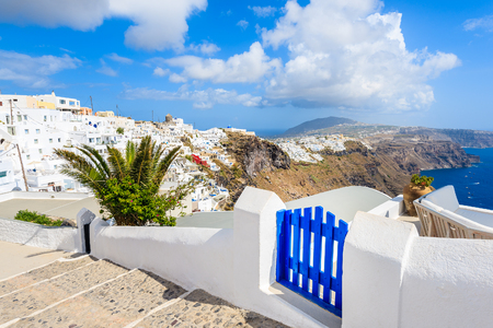View of Imerovigli village with typical white Greek houses and blue gate on Santorini island, Greece Stock Photo