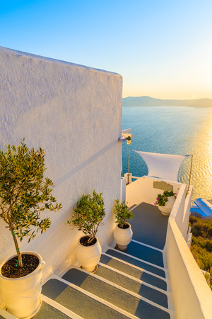 Steps in Firostefani village with sea in background at sunset time, Santorini island, Greece