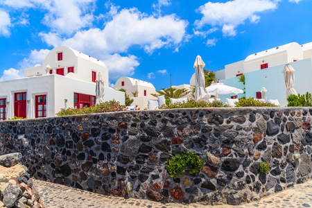 View of typical Greek style apartments in Oia village on Santorini island, Greece 写真素材