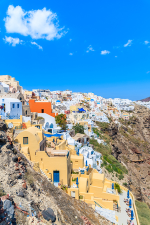 Colourful houses in Oia village built on cliff edge, Santorini island, Greece