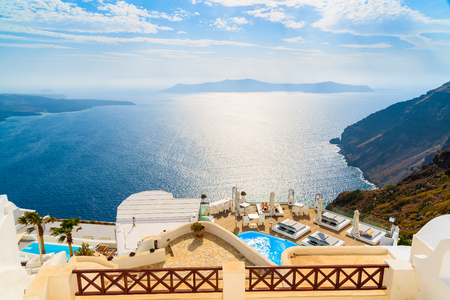 A view of beautiful sea and caldera with luxury hotel buildings, typical white architecture of Santorini island, Greece