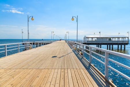 View of Jurata pier in sunny summer day, Baltic Sea, Poland 免版税图像