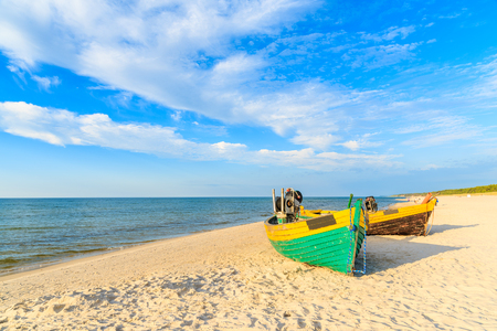 Colourful fishing boats on sandy Debki beach during sunny summer day, Baltic Sea, Poland