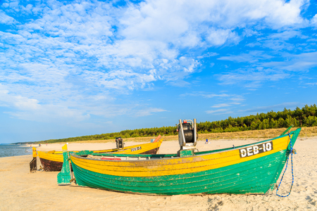 DEBKI BEACH, BALTIC SEA - JUN 22, 2016: typical colourful fishing boat on Debki beach on sunny beautiful summer day, coast of Baltic Sea, Poland. Editorial