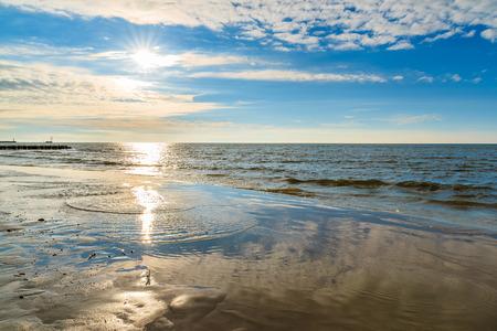 Sun shining over sea on Leba beach, Baltic Sea, Poland Stock Photo