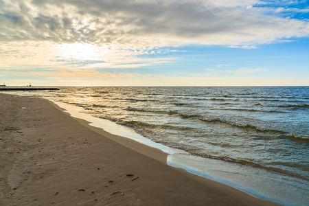 View of Leba beach during sunny day with clouds just before sunset, Baltic Sea, Poland