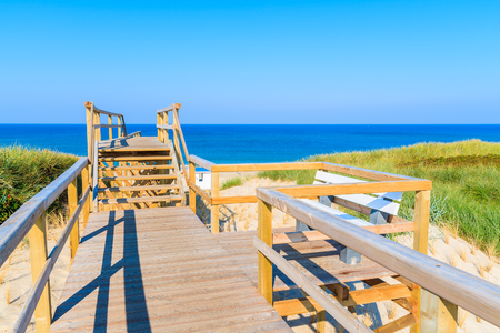 Wooden steps from sand dune to beautiful Westerland beach, Sylt island, Germany