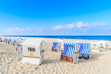 Wicker chairs on sandy beach in Kampen village on coast of North Sea, Sylt island, Germany Stock Photo