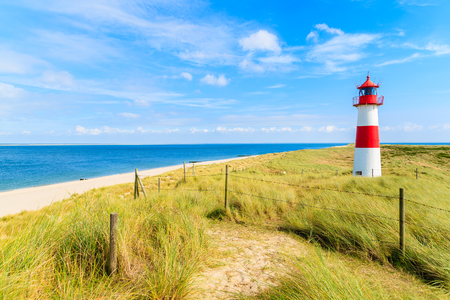 Ellenbogen lighthouse on sand dune and beach view on northern coast of Sylt island, Germany Stock Photo