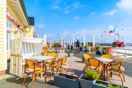 SYLT ISLAND, GERMANY - SEP 6, 2016: restaurant tables in List port on northern coast of Sylt island, Germany.