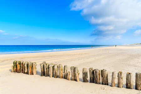 Wooden breakwaters on sandy Kampen beach, Sylt island, Germany