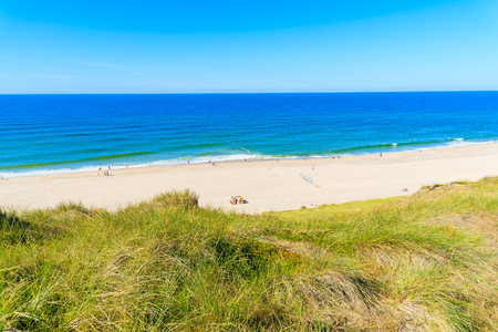 View of beautiful beach with wicker chairs in Wenningstedt, Sylt island, Germany