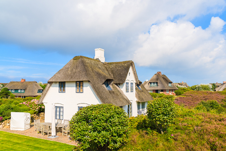 Typical Frisian houses with thatched roof on Sylt island in Westerheide village, Germany