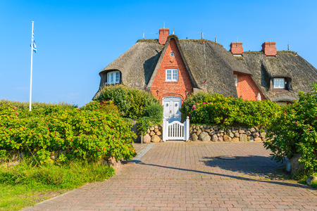 Typical frisian house with straw roof in Kampen village on Sylt island, Germany