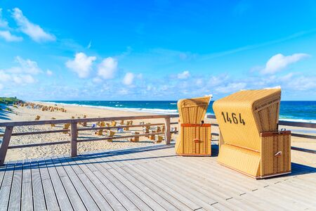 Stock Photo   Wicker Chairs On Wooden Terrace On Beach In Wenningstedt  Village On Sylt Island, North Sea, Germany