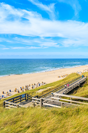 Wooden walkway to beach in Wenningstedt village, Sylt island, Germany
