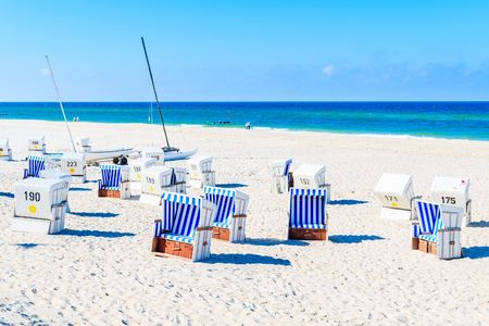 Chairs on sandy beach in Kampen village on coast of North Sea, Sylt island, Germany