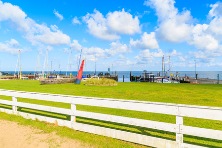 White fence in small port with boats near Keitum village on Sylt island, Germany