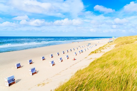 Chairs on sandy beach in List village, Sylt island, North Sea, Germany Stock Photo