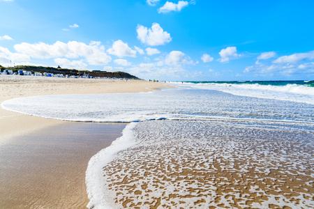 Beautiful sea waves on Kampen beach on sunny summer day, Sylt island, North Sea, Germany