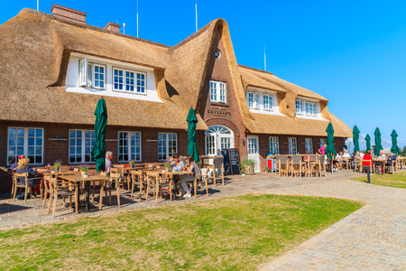 SYLT ISLAND, GERMANY - SEP 11, 2016: people dining on terrace of typical Frisian restaurant which is located near Morsum cliff.