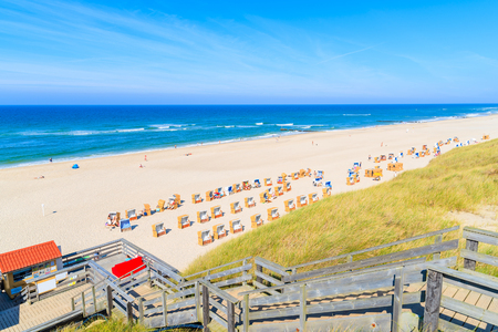Steps to beach in Wenningsted town on sunny summer day, Sylt island, North Sea, Germany Stock Photo