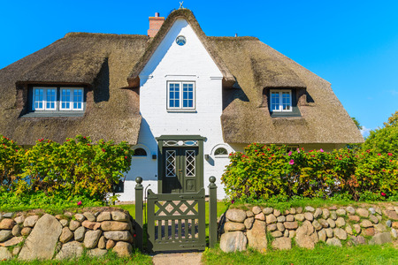 Typical white Frisian house with straw roof in Keitum village on Sylt island, Germany