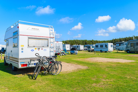 SYLT ISLAND, GERMANY - SEP 9, 2016: campers on green area of camping site on beautiful island of Sylt, Germany. Stock Photo