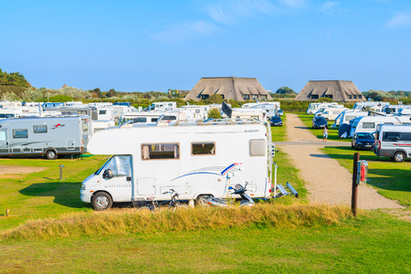 SYLT ISLAND, GERMANY - SEP 8, 2016: campers on green area of camping site on beautiful island of Sylt, Germany.