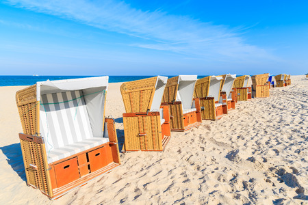 Beach chairs in morning light on sand, Sylt island, Germany