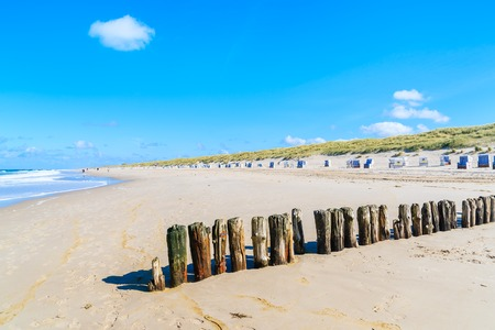 Wooden breakwaters on Kampen beach on sunny summer day, Sylt island, North Sea, Germany Stock Photo