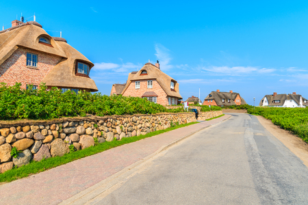 Typical Frisian red brick houses with straw roofs in Rantum village on southern coast of Sylt island, Germany