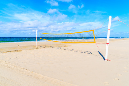 Volleyball net on white sand beach in Kampen village, Sylt island, Germany Stock Photo