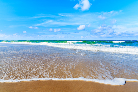 Beautiful sea waves on Kampen beach on sunny summer day, Sylt island, North Sea, Germany