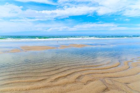 Sandy beach at low tide near List village on Sylt island, Germany
