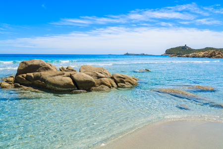 Rocks on Villasimius beach and crystal clear turquoise sea water, Sardinia island, Italy