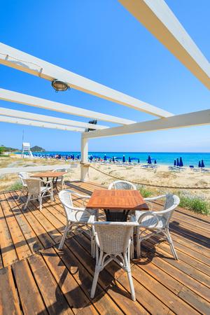 Beach restaurant in Cala Sinzias on sunny summer day, Sardinia island, Italy