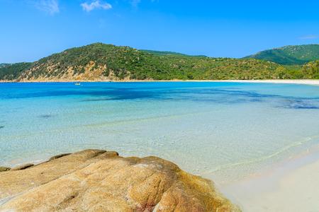 Rocks in turquoise sea water of idyllic Cala Pira beach, Sardinia island, Italy