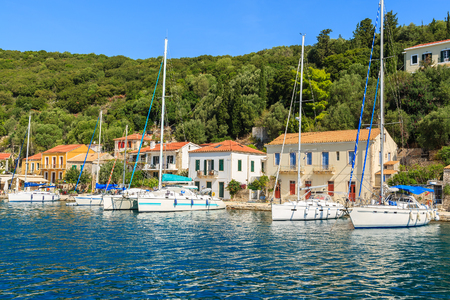 Sailing yacht boats in Kioni port, Ithaca island, Greece