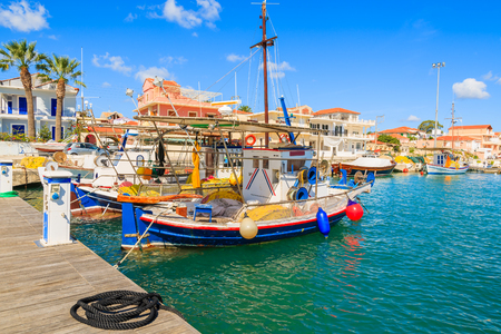 Colourful traditional Greek fishing boats in port of Lixouri town, Kefalonia island, Greece Stock Photo
