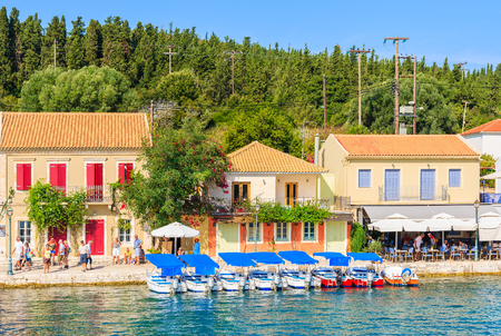 FISKARDO PORT, KEFALONIA ISLAND, GREECE - SEP 19, 2014: traditional greek houses in port of Fiskardo village. This town is most visited tourist attraction on the island.