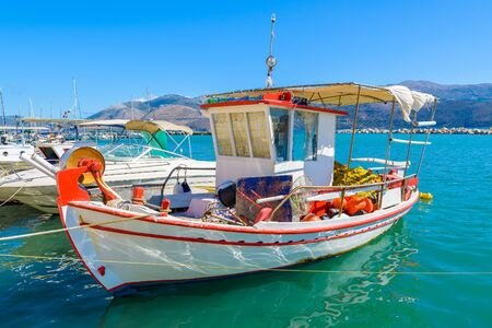 Traditional greek fishing boat in port of Lixouri village, Kefalonia island, Greece Stock Photo