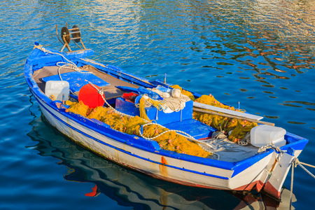 Traditional Greek fishing boat on sea water in Agia Efimia port, Kefalonia island, Greece Stock Photo