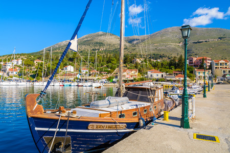 AGIA EFIMIA PORT, KEFALONIA ISLAND, GREECE - SEP 18, 2014: traditional wooden yacht boat in port of Agia Efimia village. Yachting is a popular activity on Greek islands.