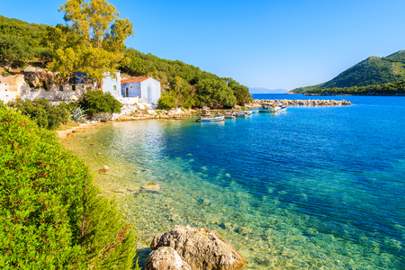 View of bay with old house and fishing boats, Kefalonia island, Greece Stock Photo