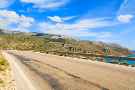 Scenic coastal road in mountain landscape of Kefalonia island, Greece