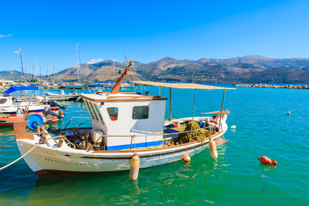 LIXOURI PORT, KEFALONIA ISLAND - SEP 17, 2014: Greek fishing boat in Lixouri port. Greece is popular tourist destination in Europe.